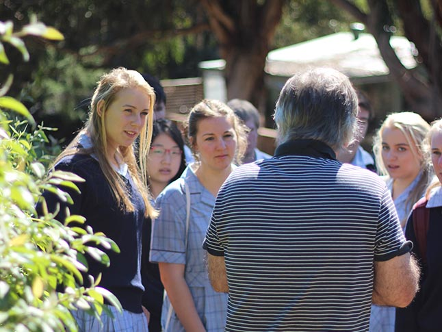 Warren with students on tour.
